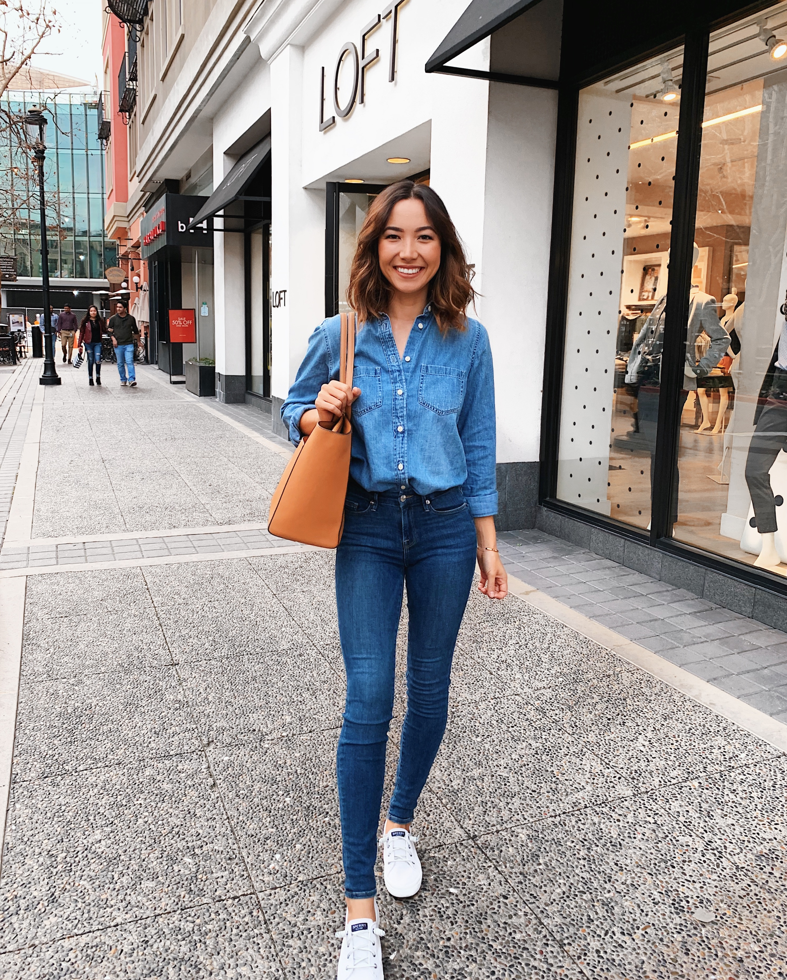 90e71f24d7 Brunette wearing casual outfit denim shirt and jeans with white sneakers  every day wear
